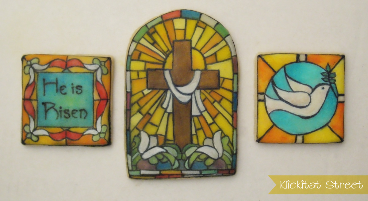 sugar cookies decorated to look like stained glass church windows