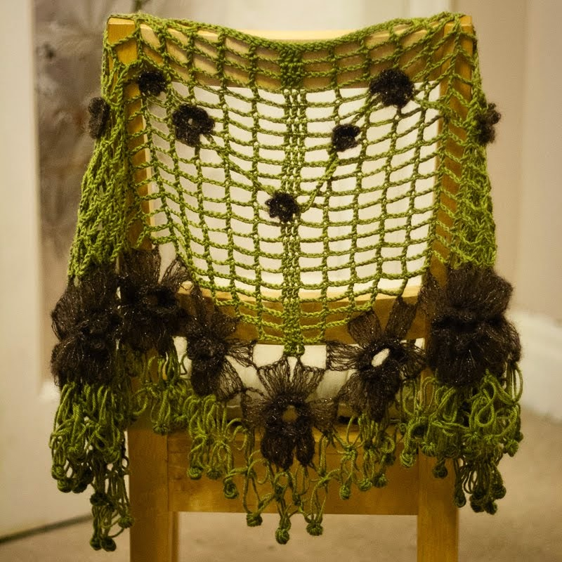 shawl draped over the back of a chair