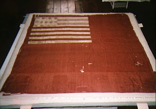 Art conservation of the Brandywine Flag by textile conservator Gwen Spicer, historic flags, Revolutionary War, repair and restoration