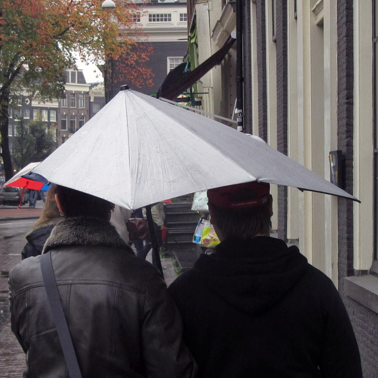couple under a lopsided umbrella