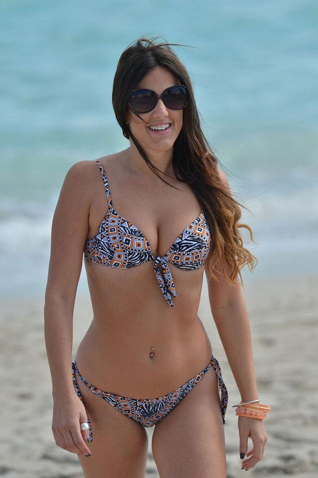 Claudia Romani shows off bikini curves and belly stud in Miami