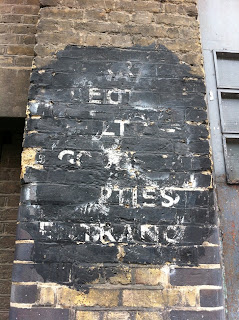 Ghost sign in Garden Walk, Shoreditch, London EC2