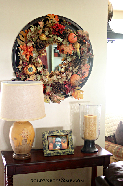 Fall wreath, Target lamp and crate and barrel hurricane on console, part of Fall Home Tour via www.goldenboysandme.com
