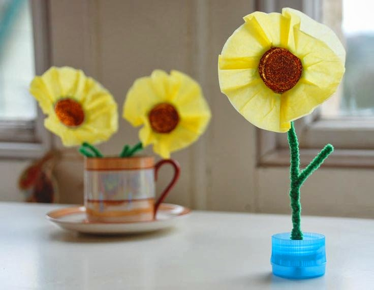http://zingzingtree.com/2013/02/22/plastic-bottle-top-craft-spring-flowers/