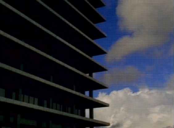 70's Los Angeles office building. 90's tv screen. Sonic Youth Still / screenshot from Little Trouble Girl (1995)