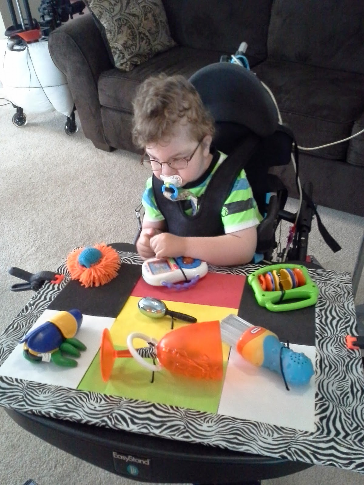 child with deafblindness playing with a toy tray