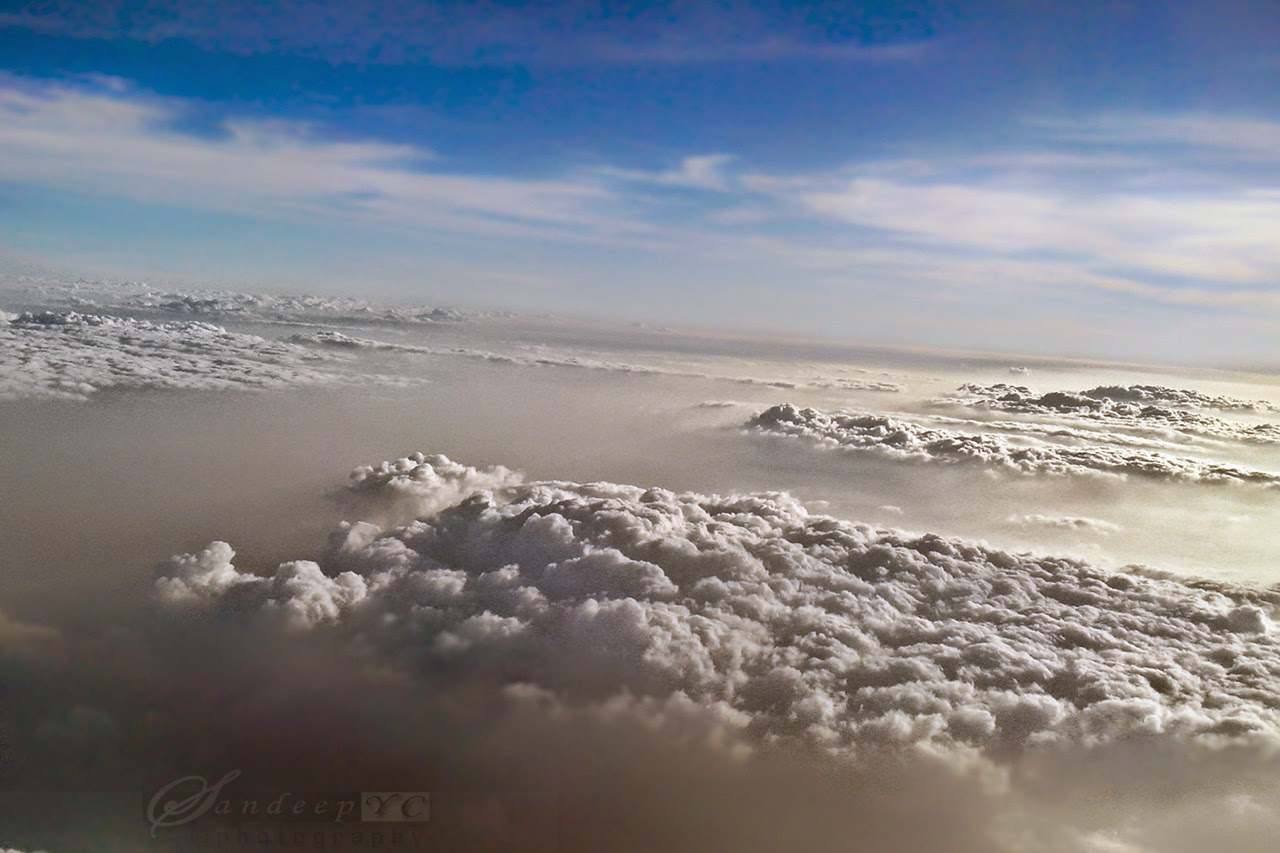 Above the Heavenly Clouds and the blue sky above, view from the Flight