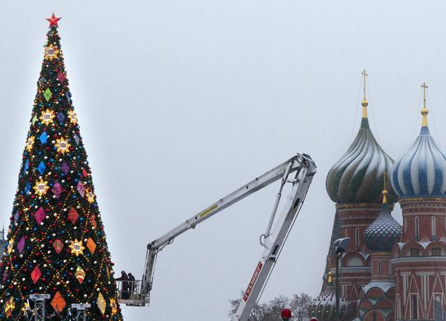 Workers decorate a Christmas tree in the center of Moscow