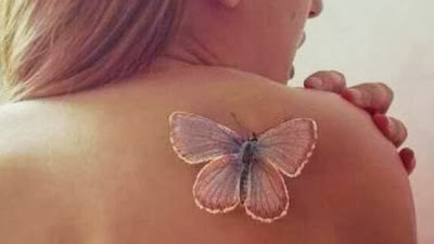 Pretty butterfly White Ink Tattoo with exquisitely soft pastels for Girls.