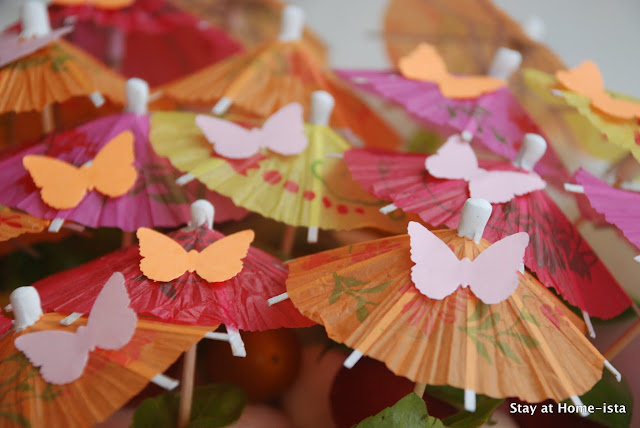 Cocktail umbrellas with paper butterflies on top