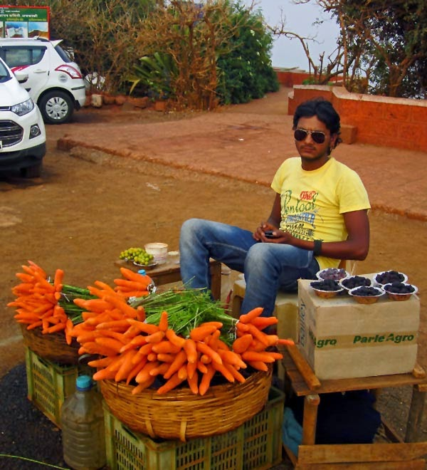 Man selling carrots at mahabaleshwar