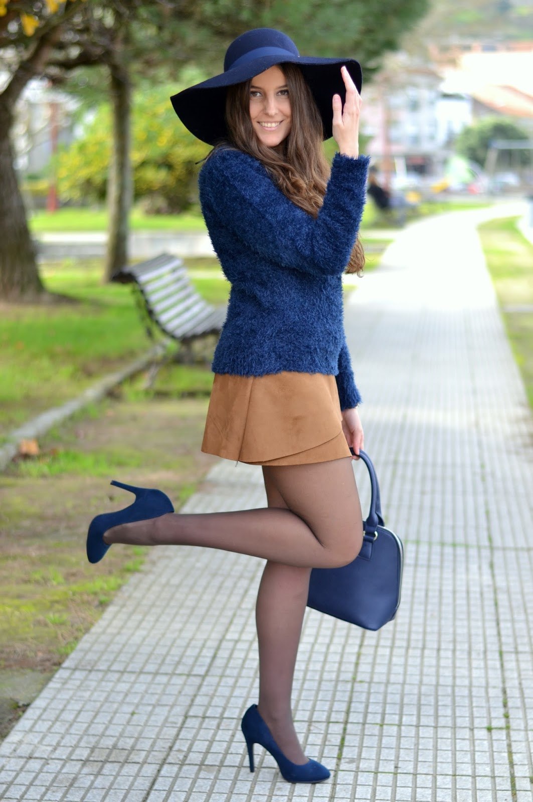 blue hat and sweater with brown skirt