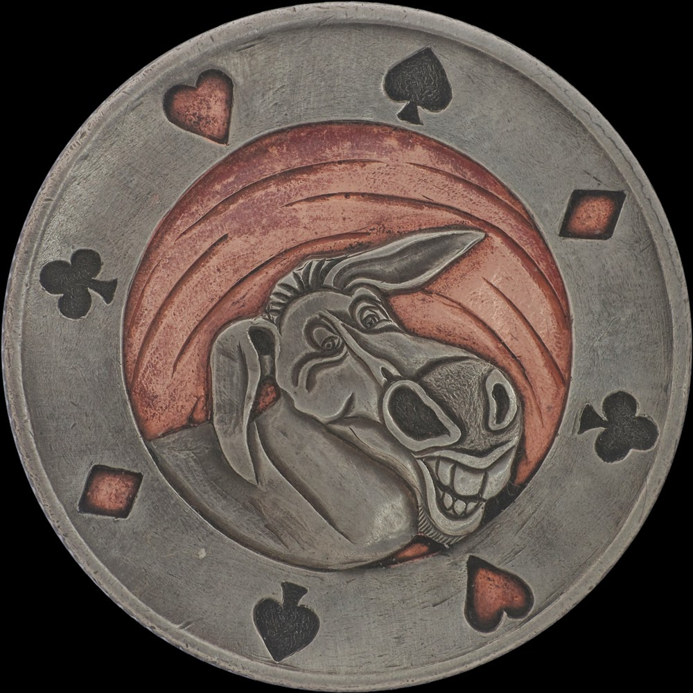 16-Donkey-Paolo-Curio-aka-MrThe-Hobo-Nickels-Skull-Coins-&-Other-Sculptures-www-designstack-co