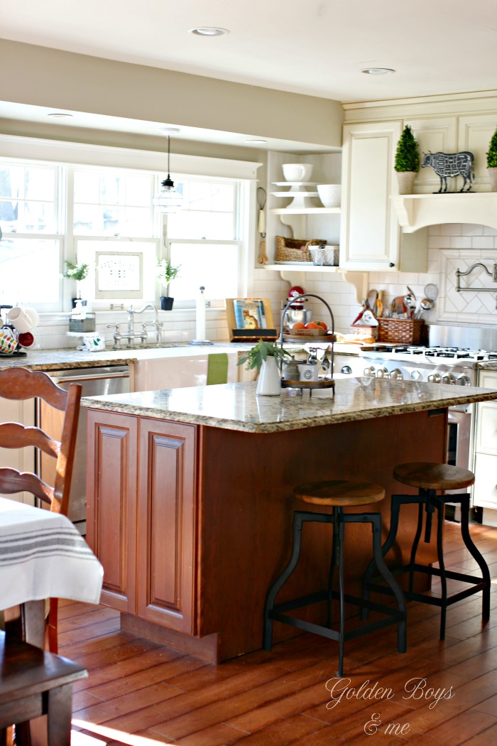 Farmhouse style kitchen with white cabinets and cherry island - www.goldenboysandme.com