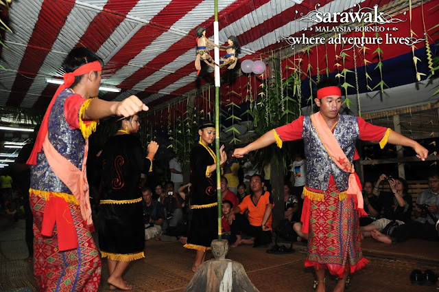 Bidayuh dancers performing at a Harvest Festival gathering known as 'Gawai Dayak'