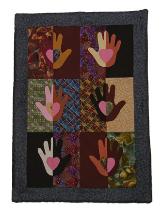 Hearts and hands wall quilt
