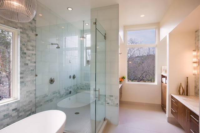 Photo of modern bathroom with the shower cabin and bathtub