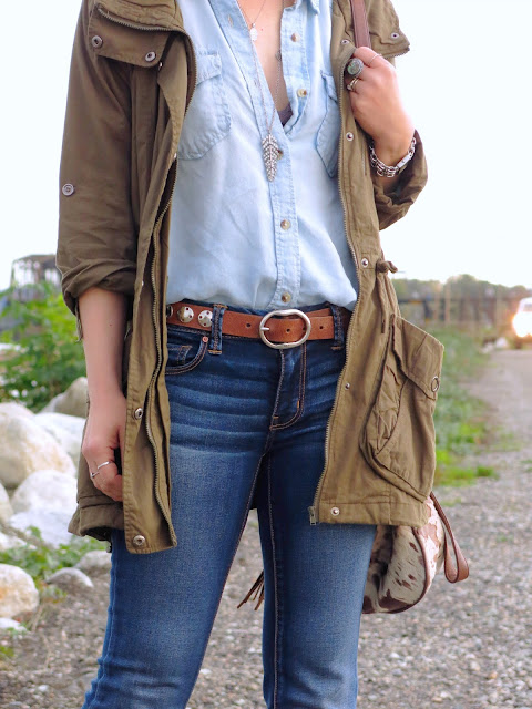 chambray shirt, flare jeans, and an army parka