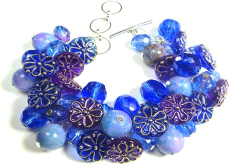 Bold bracelet has blue flower buttons, Jade and Fire Polished Czech Beads