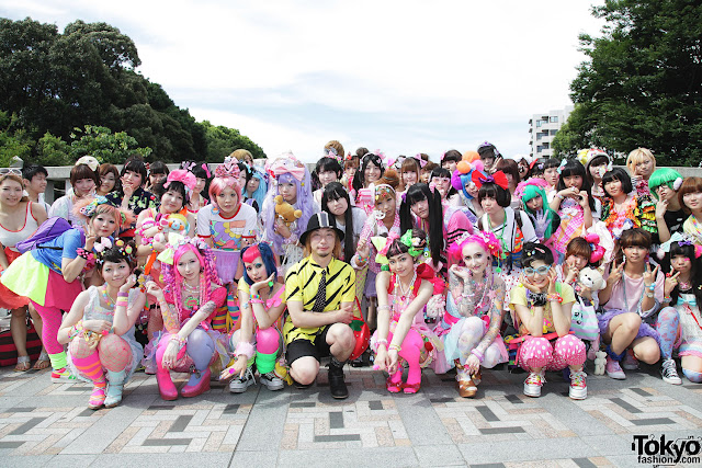 a bunch of japanese in harajuku decora kawaii dressed stuff. a lot of pink