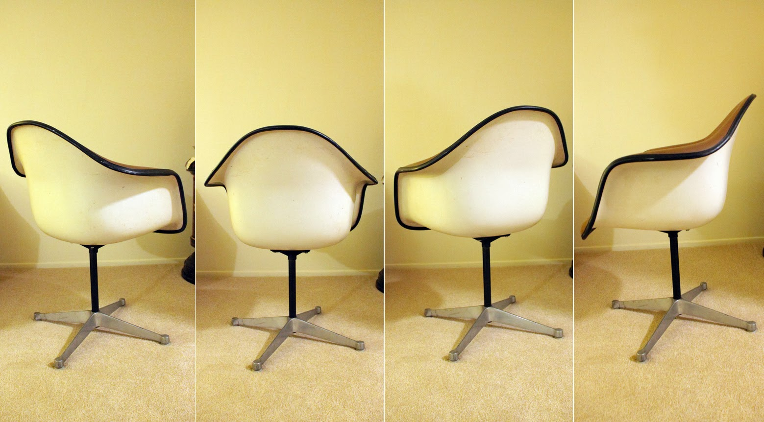 A Herman Miller Fiberglass Based Swivel Shell Chair In White And Brown.  Chair Is Upholstered With A Fabric Seat And Vinyl Sides. Base Is Aluminum.
