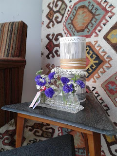 Vintage cruet with cornflowers.  Tuckshop Flowers Birmingham.  Weddings, funerals and events flowers to order.