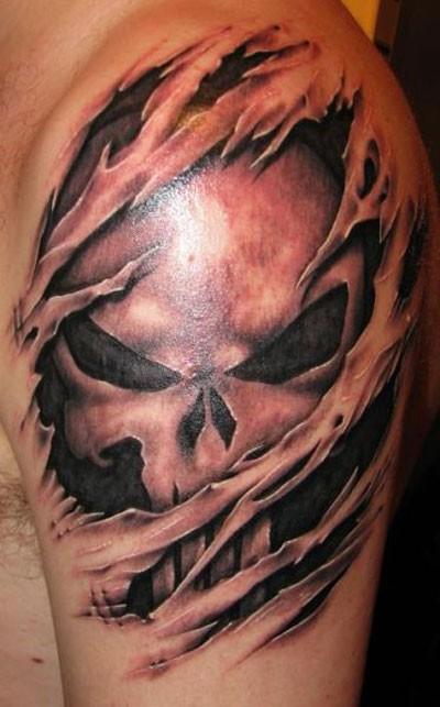 Spooky skull skin rip tattoo