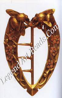 A belt-buckle design of hornets (1907): carved gold and enamel.