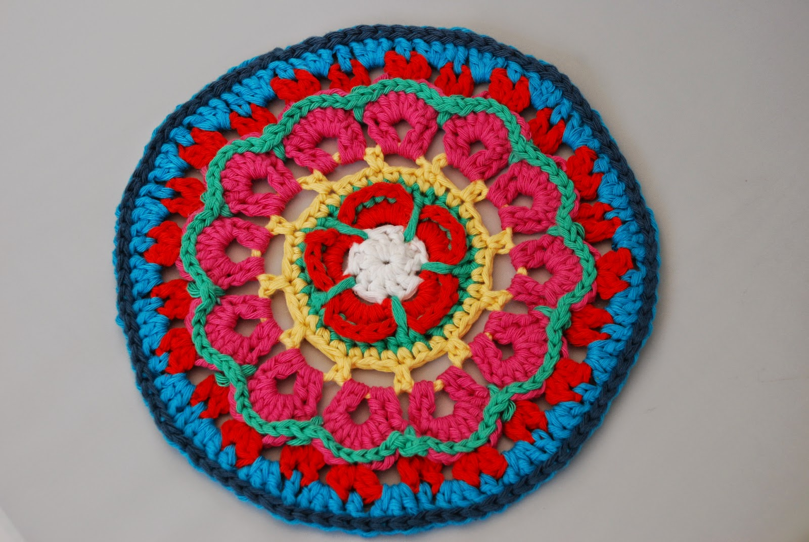 Yarndale mandala: image of hearts and flowers crochet mandala