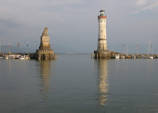 View of the lion and new lighthouse at entrance to Lindau harbor, Lindau, Germany