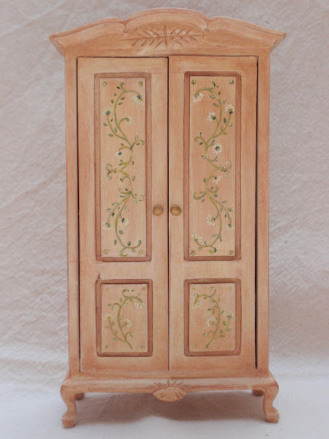 Dollhouse miniature wardrobe in cream and light brick with floral pattern in the doors 12th scale by Miniatures Forever
