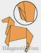 Bước 14: Gấp cạnh giấy lên trên vào trong giữa hai lớp giấy.