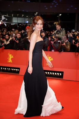 Olga Kurylenko in J. Mendel strapless gown at Berlin Film Festival Closing Ceremony red carpet