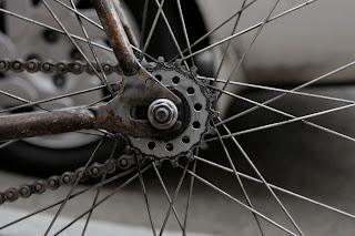 Single speed bicycle bike boylston st boston usa the biketorialist oury grips bmx style handlebar rust track frame chain cog rear wheel spokes rear dropout