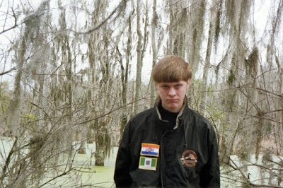 Dylan Storm Roof wore Flags of two African Nations for a Facebook shoot