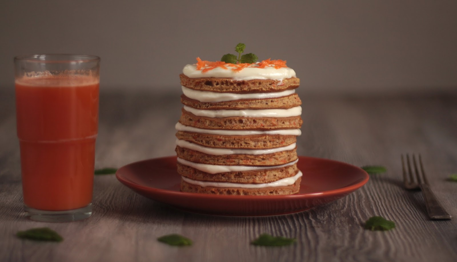 A moist pancake version of the classic carrot cake layered with the sweet cream cheese frosting - the perfect recipe for Easter breakfast or dessert. Recipe brought to you by Pancake Stories.