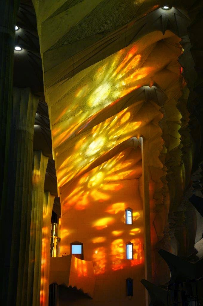 Beautiful light from stained glass windows in Sagrada Familia, Barcelona Spain.