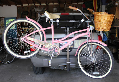 vintage style pink bike on a rear bike rack