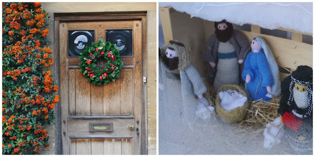 A knitted nativity and a wreath-adorned door