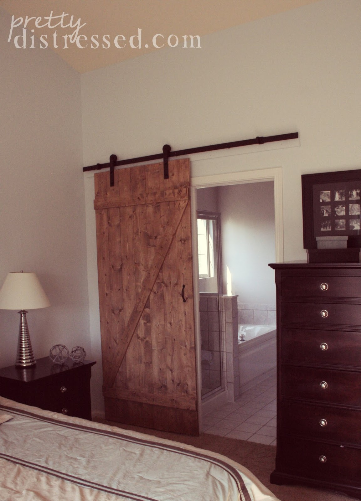 pretty distressed diy distressed sliding barn door. Black Bedroom Furniture Sets. Home Design Ideas
