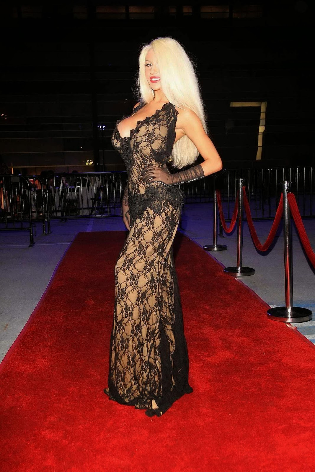 Courtney Stodden braless wearing black low cut lace dress 2014 Style Fashion Show Party in Los Angeles