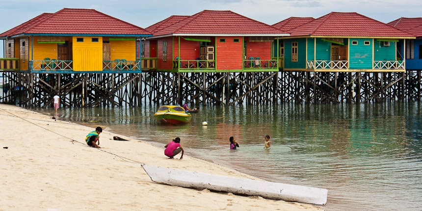 children playing on the beach of Derawan Island, East Kalimantan, Indonesia