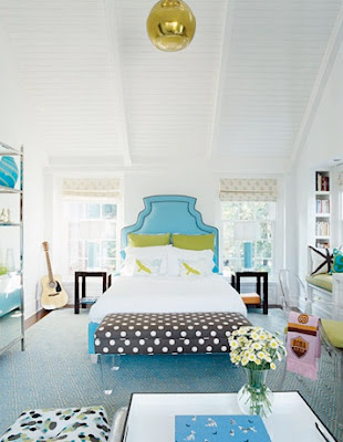 girly bedroom. dramatic headboard, beam ceiling