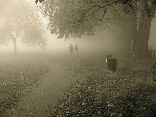 foggy morning runners on clapham common north side, london sw4