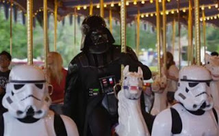 Darth Vader riding a horse on a carrossel