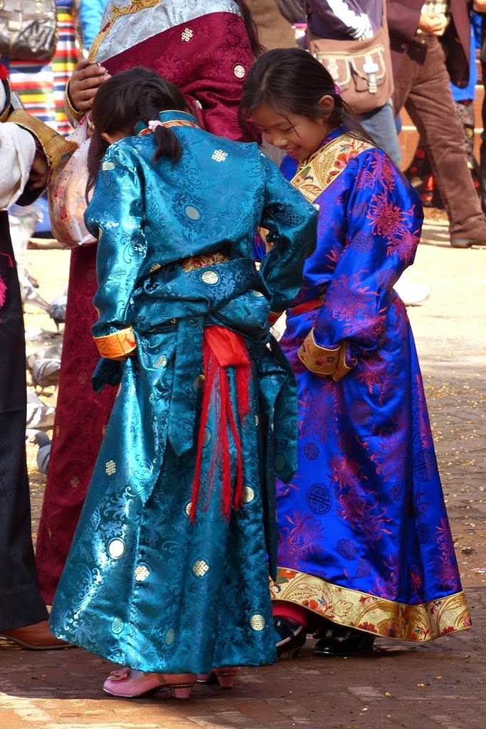 Girls in traditional Tibetan dress