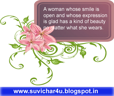 A waoman whose smile is open and whose expression is glad has a kind...