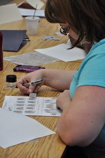 Teacher compares fingerprints.