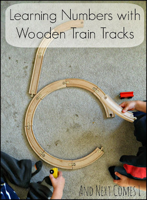 Learning numbers with wooden train tracks from And Next Comes L