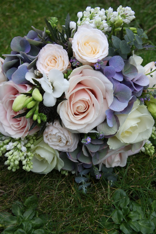 A gorgeous Vintage Pink Blue wedding bouquet in lovely spring blooms